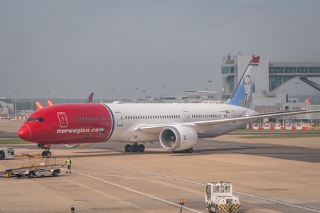 Norwegian 787 aircraft during runway taxi at London Gatwick Airport Редакционное
