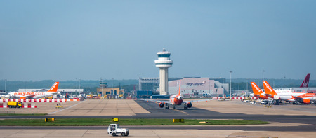 Easyjet flights parking and on taxi route to runway at London Gatwick Airport