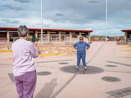 Tourists take photos at the Four Corners Monument where New Mexico, Utah, Arizona and Colorado meet