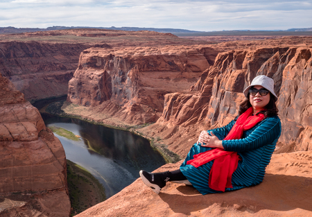 Asian tourists posing for photos at the Horseshoe Bend Arizona