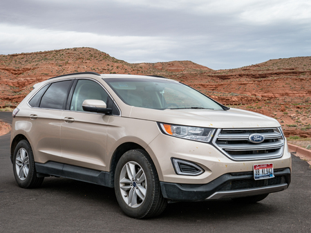 Ford Edge SUV photographed near the grand canyon in arizona with mountains in the background