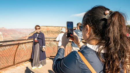 Tourists posing for selfie photo at the Grand Canyon Arizona South Side Editorial
