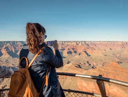 Asian tourists posing for photos at the Grand Canyon South Side Arizona Фото со стока - 122971830