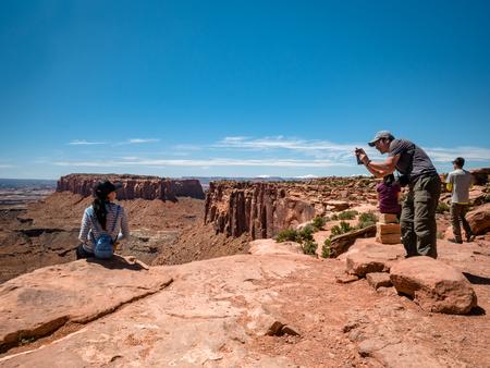 Asian tourists posing for photos at the Canyonlands Utah Фото со стока - 122971836