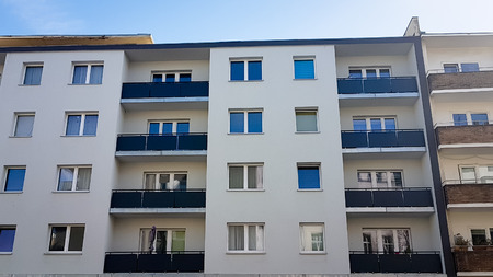 Berlin, Germany - May 25, 2019: Typical German residential apartment block in the suburbs of Berlin Редакционное