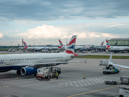 Collection of British Airways planes parked at gates at LHR London Heathrow Airport