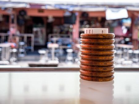 Pattaya, Thailand - August 1, 2019: Traditional thai wooden cup used to hold a customers receipt or bar bill. Known in thailand as the cheque bin or check bin Stock Photo - 128780988