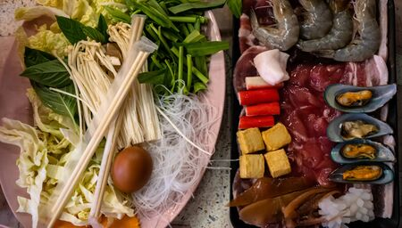 Pattaya, Thailand - August 1, 2019: Traditional Thai Barbeque BBQ with seafood, beef and pork and a mixture of vegetables and mushrooms. Perfect meal for sharing 스톡 콘텐츠