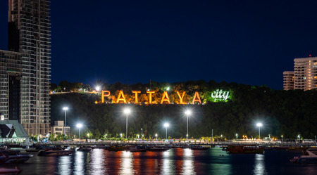 Pattaya, Thailand - August 1, 2019: Close up View fo the famous Pattaya City sign lit up at night Redactioneel