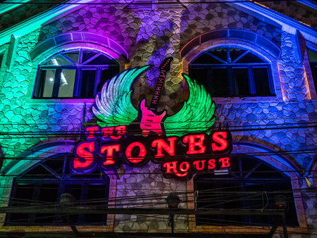Pattaya, Thailand - August 1, 2019: Neon signs and billboards on the famous Walking Street in pattaya. Known for its gogo, beer bars and clubs.
