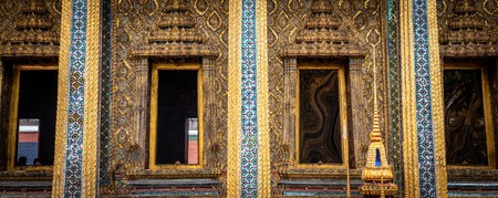View of Bangkoks Grand Palace ornate and decorative buildings. The craftsmanship and detail is outstanding with many buildings containg gold leaf and coloured glass