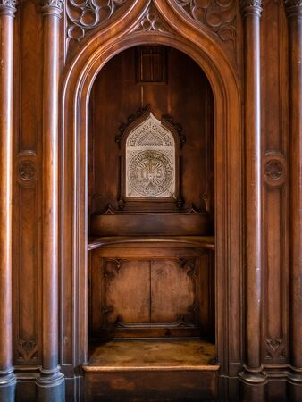 Example of a traditional catholic confession box where people