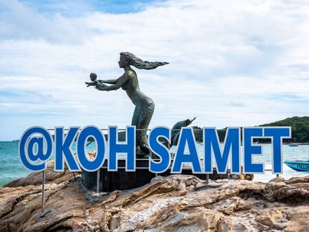 The Official Koh Samet sign welcoming people to the Island. Beautiful statue of mermade holding baby teaching it to swim.