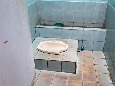 Traditional Thai and Asian toilet. Basically it's a whole in the ground you have to squat over Zdjęcie Seryjne