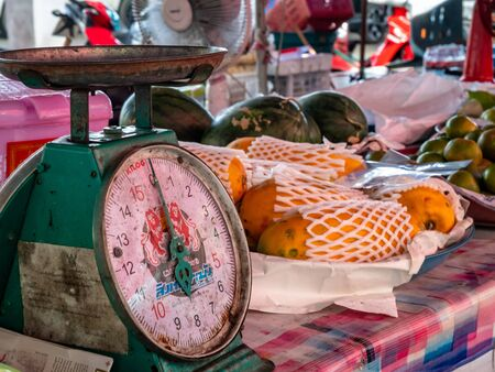 Set of really old market scales found at fruit stall on the island of Koh Samet Thailand
