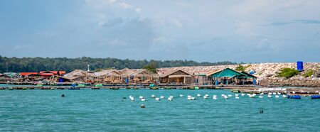 Floating village built out into the dock of Rayong. It includes some fish farms also