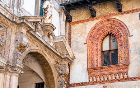 Example of old Italian window architecture found in the old quarter in the center of Milan Italy