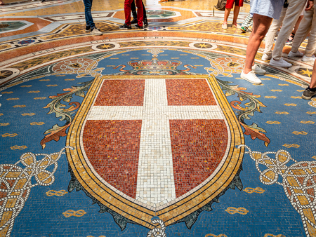 Mosaic crest adorning the floor of the famous shopping mall in Milan the Galleria Vittorio Emanuele II near the famous Duomo
