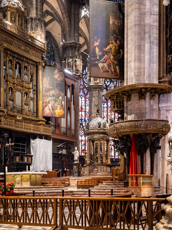 Catholic Interior of the famous Milano Duomo Cathedral. The Icon of Milan and a must visit sight for anyone on vacation or sightseeing Publikacyjne