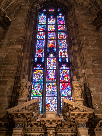 Old Catholic ornate beautiful Stained glass windows from the famous Milano Duomo in the Heart Milan Italy