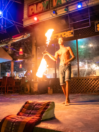 Fire Dancer performing routine at night on the Thai island of Koh Samet Thailand Publikacyjne