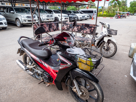Customised Motorbike Thai Style for transporting people and goods to various boats on the dock at Rayong bound for the island of Koh Samet Thailand Publikacyjne