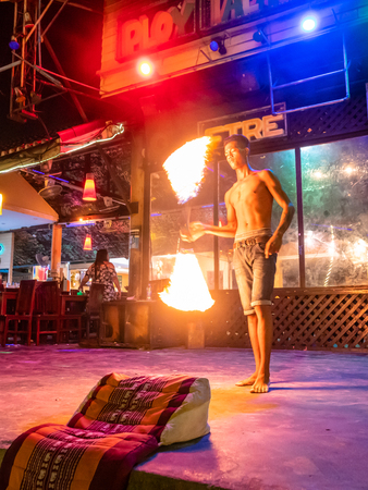Fire Dancer performing routine at night on the Thai island of Koh Samet Thailand Redactioneel