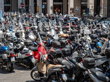 Genoa, Italy Large Collection of Motorcycles parked in the city centre. motorbikes or mopeds are a popular way to get around the city. Less pollution city centre car ban Standard-Bild - 139776114