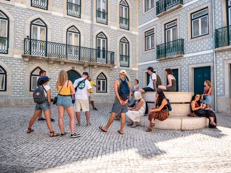 Lisbon Portugal A Group of Tourists On a Walking tour Shot Midday in Summer Enjoying the attractions group of Adults September 13, 2019, Free tour organised by the hostel for its backpackers. Standard-Bild - 139859978