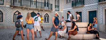 Lisbon Portugal A Group of Tourists On a Walking tour Shot Midday in Summer Enjoying the attractions group of Adults September 13, 2019, Free tour organised by the hostel for its backpackers. Standard-Bild - 139859897