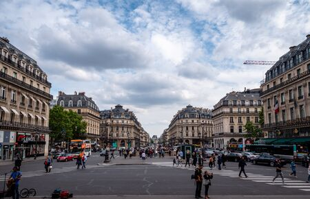 Street view of central Paris at the Opera Subway station. Showing everyday Paris city life of locals and tourists