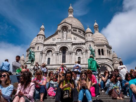 Religious Cathedral Basilique Du Sacre Coeur in Montmartre, Paris, France. Building exterior justified to allow for copy space. Sunny Summer day. Top tourist attraction. Editorial