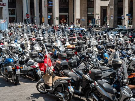 Genoa, Italy Large Collection of Motorcycles parked in the city centre. motorbikes or mopeds are a popular way to get around the city. Less pollution city centre car ban Editorial