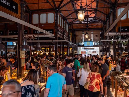 Inside the San Miguel Market building or Mercado de San Miguel in Spanish Capital. Madrids premium market and top tourist attraction for amazing gourmet Spanish food and drink. A must see must visit place