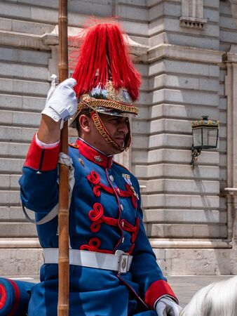 Spanish Royal Guards outside the Royal Palace of Madrid. Full military attire riding horseback. Changing of the guard is a top touists attraction and must see in Madrid. Madrid Royal Palace horse guards. Publikacyjne
