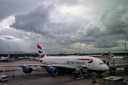 British Airways Airbus A380 at LHR London Heathrow Airport. Looking old, dirty and unclean on a grey and cloudy stormy day.