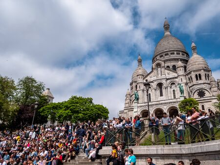 Religious Cathedral Basilique Du Sacre Coeur in Montmartre, Paris, France. Building exterior justified to allow for copy space. Sunny Summer day. Top tourist attraction. Редакционное