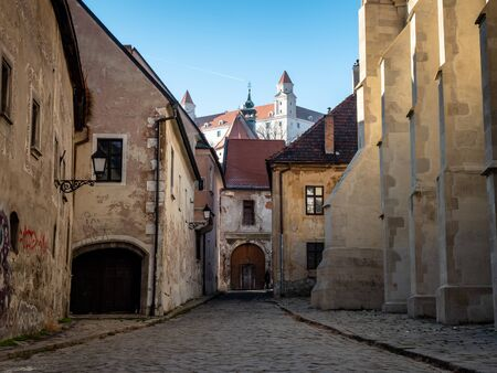 Typical European alley in the old city of Bratislava, Slovakia Фото со стока