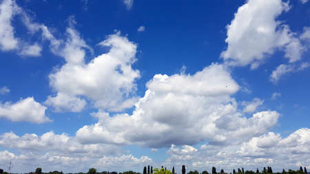 Beautiful Summer Blue Sky With White Scattered Soft Clouds
