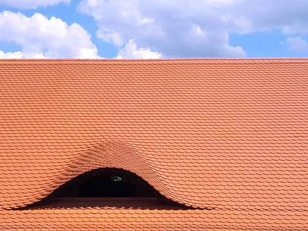 rooftiles: Wavy Rooftop Covered In Orange Brown Terracotta Tiles
