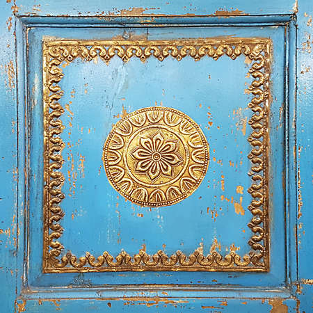 old furniture: Golden Old Rugged Handmade Decorative Ornaments On Vintage Furniture Stock Photo