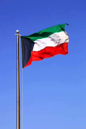Waving National Flag Of Kuwait On A Blue Daytime Sky Stock Photo