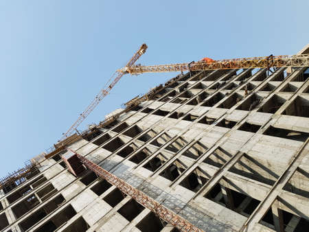 ongoing: Generic Tower Crane Attached To An Ongoing Building Construction Stock Photo