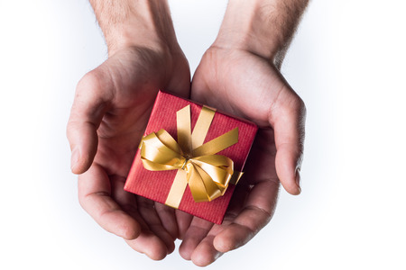 Concept hands giving gift on white background