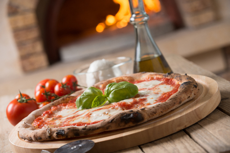 Wood oven baked italian pizza margherita