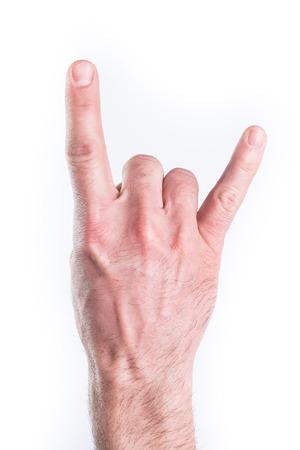 cuernos: La mano del hombre imitando cuernos sobre fondo blanco