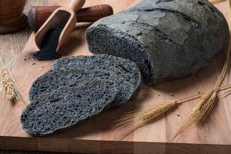 activated: Activated carbon bread - pane carbone vegetale Stock Photo