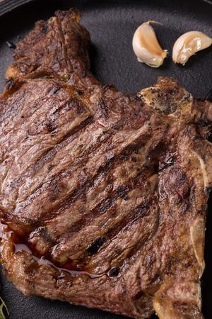 a rare: Top view of grilled rare rib steak Stock Photo