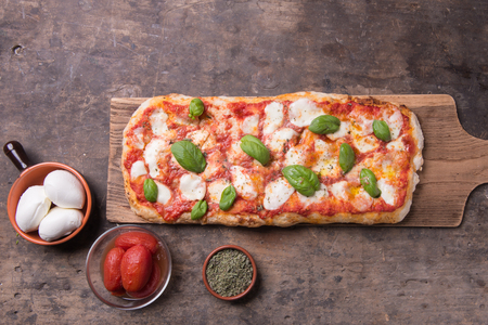 Pala romanas pizza on top view rustic still life composition Reklamní fotografie