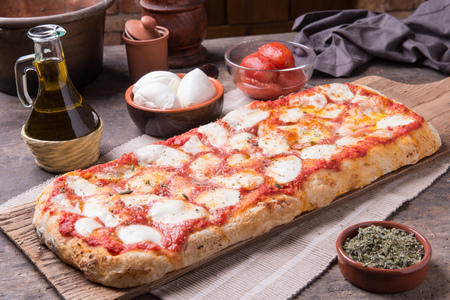 Rectangular shape and thick hand made romana's pizza Archivio Fotografico